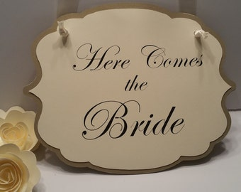 Here comes the Bride ceremony sign.
