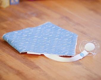 Bandana bib with pacifier clip