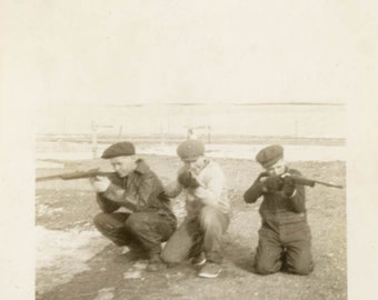 vintage photo 1919 Three Young Men Shooting guns Different Directions Cap Overalls
