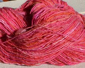 Skein of handspun fuchsia and orange