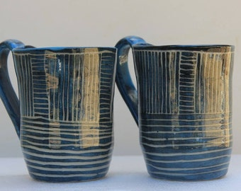 Stoneware mug with blue carved slip and clear gloss glaze