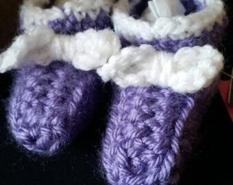 Purple booties with cute white bows