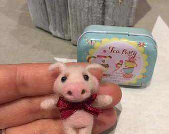Handmade pig made of carded wool.