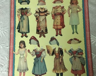 McLoughlin Bros Dressing Dolls