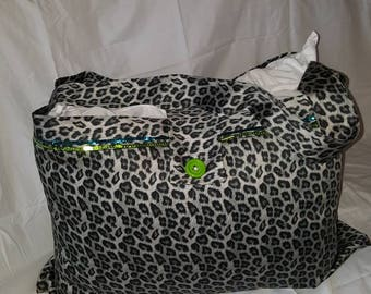 Leopard print pillow bag with button closure.