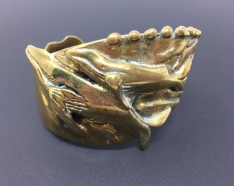 Heavy thick artist made brass cuff bracelet featuring 2 whales