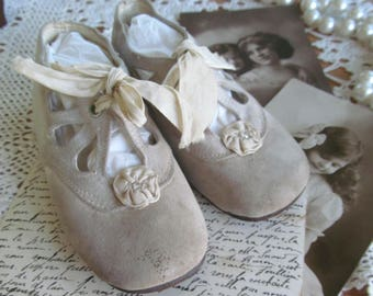 Adorably petite vintage French childrens shoes~Soft grey suede with ruffled rosette & ribbon ties~Lined with white kid leather~Sweet display