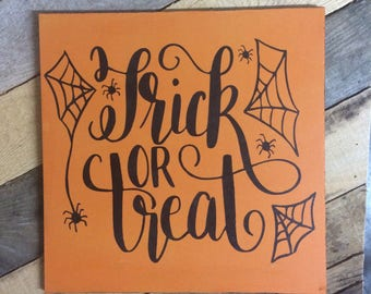 Trick or treat sign. Halloween sign. Wooden halloween sign.