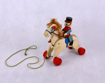 Wooden pull along toy horse