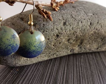 Enamel on copper, green with cobalt blue accents, 3/4  inch round, surgical steel ear wires