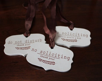 small ceramic sign - no soliciting thank you . no soliciting unless youre a kid or do not disturb