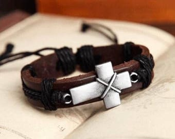 Leather bracelet with woven string ans metal cross.