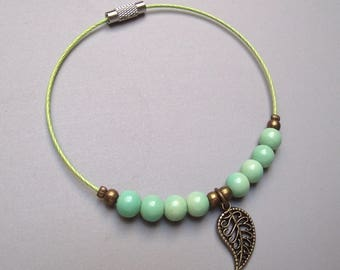 Handmade bracelet pistachio green glass beads.