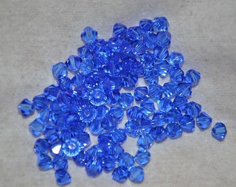 20 - 6mm Genuine Swarovski Crystal Beads - Sapphire