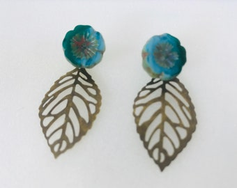 Blue flower studs with bronze leaf earring jackets