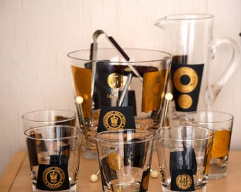 Mid Century Bar Set. 10 piece set. Ice Bucket, 6 glasses, Jug, Corkscrew and  Ice tongs .Black and gold. Gorgeous set.