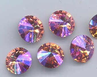 Yowza!  Four gorgeous Swarovski rose peach glacier blue rivolis - art 1122 - 12 mm