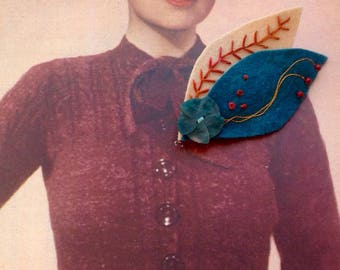 Flower embroidered felt brooch with vintage button and beads.