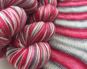 Hand dyed self striping merino sock yarn - Love Bomb
