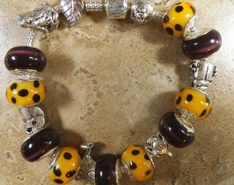 Halloween Cheetah Design European bead bracelet in black and gold and multi animal charms - MB140
