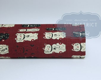Japanese Maneki neko red background fabric.