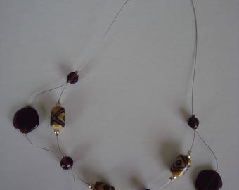 Woman purple and beige beaded necklace