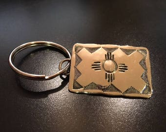 A Navajo Key Ring in Silver with Zia Sun Symbol