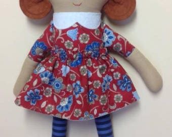 Flavie - Rag doll, red floral dress, rain blue leggings, red shoes.