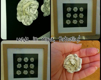30 x 30 cm oak 3d frame with 9 hand assembled paper roses with black backing.