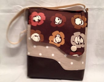 AC14- Crossover: rows of flowers bag with magnet closure, front and inside pocket and adjustable strap