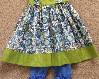 Green and blue print top with periwinkle blue ruffled icing capris