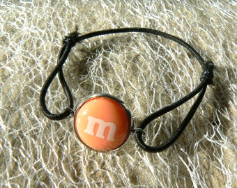 M bracelet & me s pale orange elastic sliding knot black cabochon 14mm