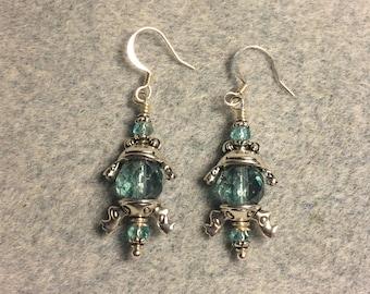 Silver frog bead cap dangle earrings around large light teal Czech glass beads.