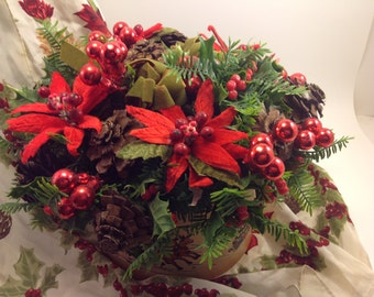 vintage Christmas holiday flower arrangement centerpiece in round faux tooled leather planter with embossed winter scenes