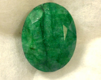 251 carat  .....  faceted emerald gemstone  ...  44 x 34 x 22 MM