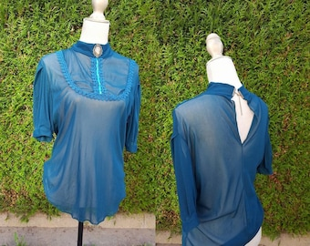water green blouse