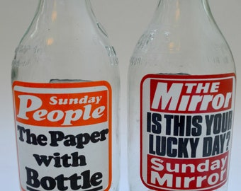 Two Vintage 1980's Milk Bottles Advertising Newspapers