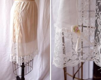 Little Flower | Vintage Half Slip 1980s Lingerie White Nylon Tricot Petticoat Lace Side Panel and Hem Flower Bow Trim Sliperfection Size S