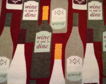 Double kitchen towel with red, Burgandy,  gray wine bottles. Red top.
