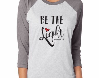 "Ladies, ""Be The Light"" White/Grey 3/4 sleeve, Ringer Tee"