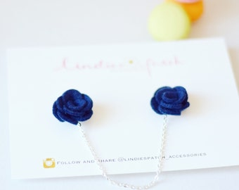 A set of navy blue flower collar clips with a 10cm gold or silver chain to wear with collared shirts, dresses or as cardigan clips
