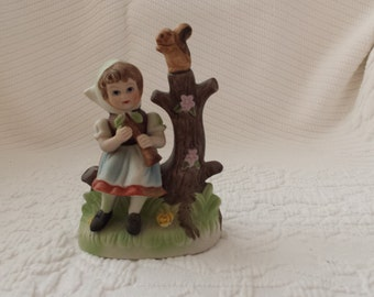 Girl on a tree with a squirrel