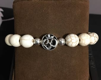 White turquoise with sterling silver OM symbol