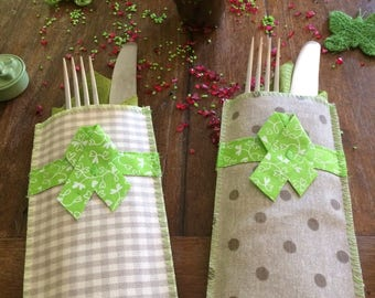 Pair of pockets to individual covered in coated cotton, flatware holder