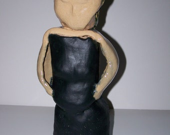 sculpture of woman in clay