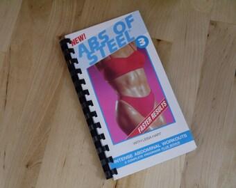 La main Abs acier 1994 d'entraînement exercice vidéo VHS reciblées couverture cahier Journal