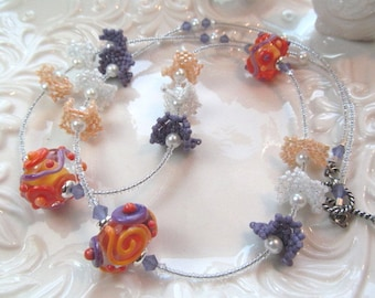 Necklace orange purple glass art lampwork beads, beaded pinwheels, crystals and glass beads