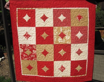 Red and Tan Bandana Print Cathedral Window Quilt