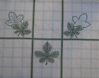 Embroidered green leaves