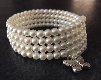 Pearl beaded memory wire bracelet with butterfly charm